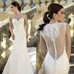 Loire    This gown is an absolute dream of a dress! The lace applique is so delicate and the buttons are draped all the way along the back.    Available in Ivory or White.