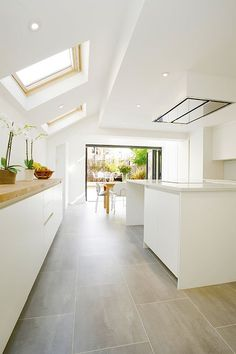 Single storey extension ideas. Roof windows and bi-fold doors let in light.