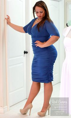 """Stunning model Christine (5'7"""" and a 1x) models her sexy curves in our plus size Betsey Ruched Dress for the chic SexyPlus Clothing boutique in Canada."""
