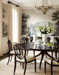 """""""In the dining room of a house in Purchase, New York, designer Gideon Mendelson put a fresh spin on scenic wallpaper by cutting up Zuber's Courses de Chevaux into scenes and framing them in molding."""" photo credit: Eric Piasecki  via House Beautiful"""