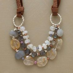 "Copper beads, pink sapphires, grey and rainbow moonstones, labradorites, rutilated quartz and iolite, sterling silver, on leather straps 18"" necklace"