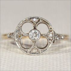 The cathedral window design sports a stunning full cut diamond and another 6 single cut diamods
