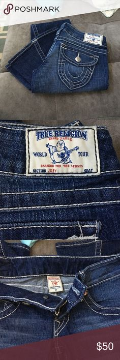 NWOT True Religion Jeans Brand New NEVER WORN low rise Joey True Religion Jeans. Beautiful button back pockets. Stunning detail in stitch work. Very comfortable.Unfortunately they are a bit to big around my waist. IMPECCABLE CONDITION❤️ True Religion Jeans Flare & Wide Leg