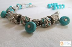 A shimmering silver, sea blue turquoise stone beaded snake chain bracelet, with matching sea blue turquoise stoned earrings.