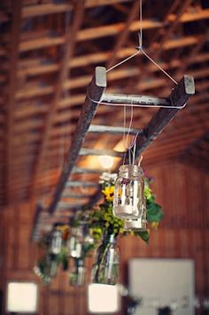 Old rustic ladder with hanging mason jars & flowers. Hang this over a food table or use as decor for parties or a wedding.