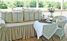 Cedar Hill Farmhouse porch. Love those pillows.