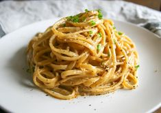 creamy, spicy, decadent cajun cream sauce coats every strand of this linguine pasta dish. topped with parmesan cheese and green onion, it's a small batch recipe for two (plus a little extra!) that is a favorite! creamy cajun linguine   a flavor journal   small batch recipe