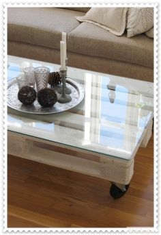 Glass-topped Wood-pallet, on Casters, as a Sofa-table - so easy!! Love