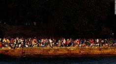 People line the harbour in anticipation of New Year's Eve celebrations in Sydney on Monday, December 31.