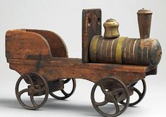 Hand Carved and Painted Wood with org. Cast Iron Wheels. English, circa 1880.