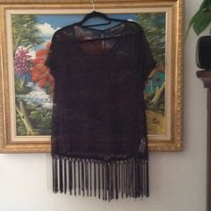 Forever 21 fringe top Black worked only once fringe top, short sleeves ready to conceal or go on top of a sexy top...really nice!!!   True to size, about 30/31 long.. Forever 21 Tops Tunics
