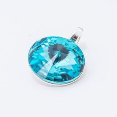Silver plated Swarovski Rivoli Pendant 12mm Light Turquoise  Dimensions: length: 1,7cm stone size: 12mm Weight ~ 1,40g ( 1 piece ) Metal : silver plated brass Stones: Swarovski Elements 1122 12mm Colour: Light Turquoise 1 package = 1 piece Price 9.40 PLN(about 2.5 EUR)