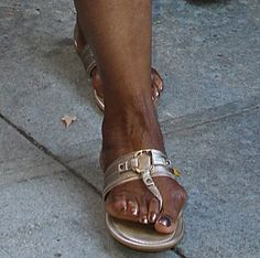 Oprah Winfrey is pretty in pink at CBS in NYC.mOh Dear, poor thing, looks painful!