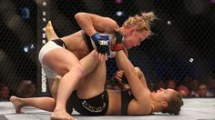Ronda Rousey vs Holly Holm is still dropping jaws. But unfortunately, nobody knows what effect this is going to have on Rousey's career. But UFC 193 just boosted Holly Holm into the big time. Her MMA and boxing skills were unanswerable Ronda Rousey, Kickboxing, Muay Thai, Jiu Jitsu, Holly Holm Ufc, Mma, Rowdy Ronda, Ufc Women, Women Boxing