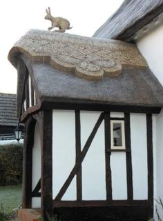can't discover exactly where this is in England, but love the signature finial on the thatch. Clcik through for some interesting facts and more great pics of straw finials. can't discover exactly where this is in England, but love the signature fin Storybook Homes, English Country Cottages, Bunny Art, Bunny Bunny, Thatched Roof, Cozy Cottage, Beautiful Buildings, Architecture Details, Landscape Architecture