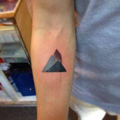 Geometric mountain tattoo