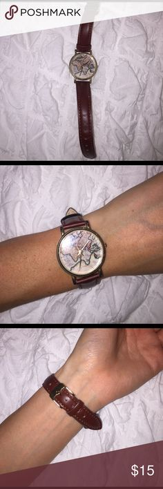 Watch with the world inside of it. Gold accents. Brown strap. Worn once. Stainless steel back. Needs a new battery. Urban Outfitters Accessories Watches
