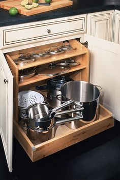 This lid storage is genius! It might work in our drawers.