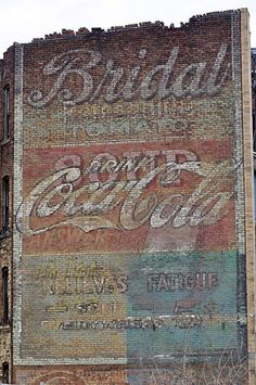 """Do you know what """"ghost signs"""" are? They're those old painted buildings from businesses long gone. Check out the photos."""