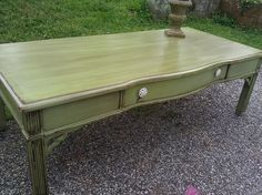 Gorgeous distressed coffee table in olive green. I absolutely love this piece!!! $75