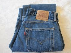 Vintage 80's or 90's 501 button fly dark blue Levi's jeans.  For Women size 33 X 34.  Please note the back label was torn incorrectly when removing the extra size part. This does not take away from t