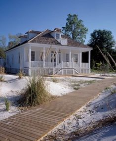 White cottage - front porch, shutters, path to the beach