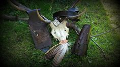 Leather archery set of three items, belt quiver with custom 'roaring bear' motif, belt with bear tracks and feathers and feather motif arm guard #archery #archeryset #leathertooling #b2zoneshoplet #b2zone