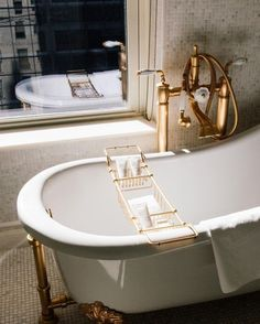 brass fixtures on old fashioned free standing tub