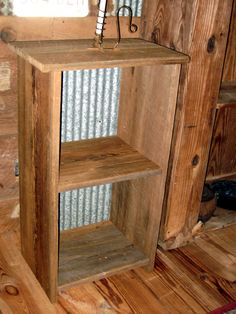 Cabinet made with reclaimed wood and tin from old cotton gin