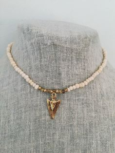 Bone and Gold Arrow Choker by MadisonMillerBeads on Etsy https://www.etsy.com/listing/221228288/bone-and-gold-arrow-choker
