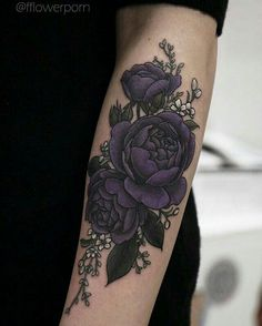 Dark purple flower tattoo