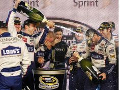 In victory, Jimmie Johnson sprayed with champagne. Nascar Heat, Cigar Lighters, Victorious, Champagne, Racing, Let It Be, Running, Auto Racing