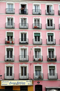 Spain - Oh what I would give to live in a lovely pink building with a lovely balcony!