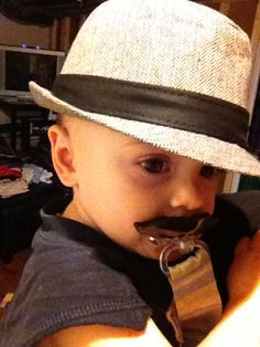 Fidora - check.  Mustache - check.  Now we need suspenders, shirt, tie and pants.  Oh this will be a fun day!!