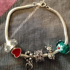 Charm bracelet Charm bracelet with 6 charms..lobster clasp..not pandora Jewelry Bracelets