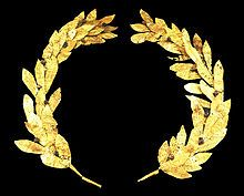 Costuming Terms Crown of Laurel Leaves: A wreath of interlocking leaves modeled after a laurel plant. It was worn by both the Greeks and Romans to symbolize victory.