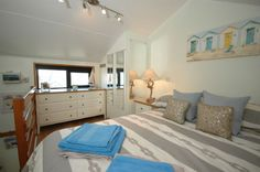 This fresh and attractive bedroom belongs to West Pier, a 1 bed apartment in Brighton Marina that rises and falls with the tide!