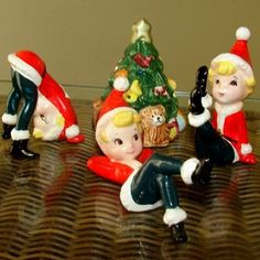 """CH122 - What a hoot these little guys are! Each one wears a Santa suit and is gathering around the tree for a fun Christmas. The tallest pixie is 3.5"""" tall. The pixies were made in Japan for Lefton. 