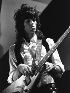 Keith Richards. Perfect hair, love the ruffled shirt.