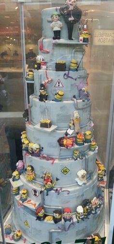 Epic despicable me tiered cake featuring every minion possible from the cake gallery in solihull. Minion madness
