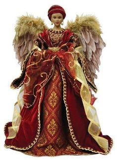 The Holiday Aisle This American African Diva Angel Tree Topper is gorgeous. She is dressed in a red coat. Her dress has a red and gold tapestry design to match. Her wings are brown faux fur and mauve feathers. Red And Gold Christmas Tree, Angel Christmas Tree Topper, Holiday Tree, Christmas Angels, Christmas Fairy, Christmas 2019, Christmas Wedding, Burgundy Gown, Black Angels