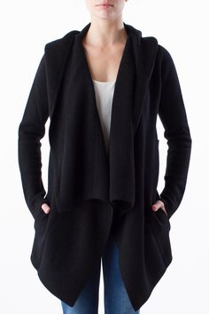 True Margaret girls know that St. Moritz is the ultimate in luxe toppers. Weighty and warm four-ply cashmere is elegantly draped in this elongated hooded shawl cardigan, which features front pockets and a covered crochet pin for easy (and chic) closure. Hand wash cold separately, do not bleach, do not tumble dry, lay flat to dry, cool iron if necessary OR dry clean.   St. Mortiz Cashmere Topper by Margaret O'Leary. Clothing - Sweaters - Cardigans Clothing - Sweaters - Cashmere New York City