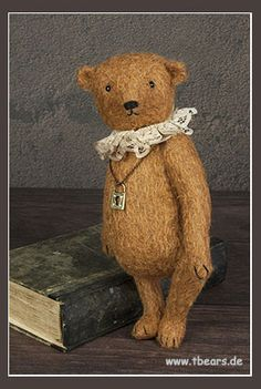 This is Heirloom, a antique style bear. He is approximately 26 cm tall.