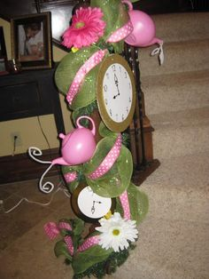 """I decorated the staircase for my daughter's tea party birthday.  Kind of """"Alice in Wonderland"""".  I made all the clocks.  www.prettifyyourlife.blogspot.com"""
