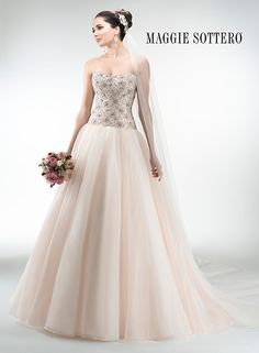Stunning romantic ballgown wedding dress, Loudes from Maggie Sottero, featuring lovely Chic Organza and a heavily beaded Swarovski crystal bodice and sweetheart neckline.