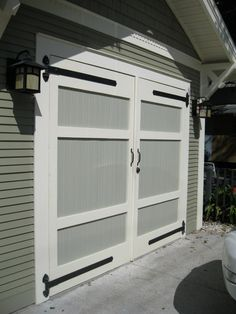 "Love the detail added to these garage doors . . . gives them a great historical ""carriage house"" feel. ♥"