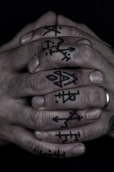 noveltymakesalchemy:    Occult symbol finger tattoos by Thomas Hooper. Hands get me every time.
