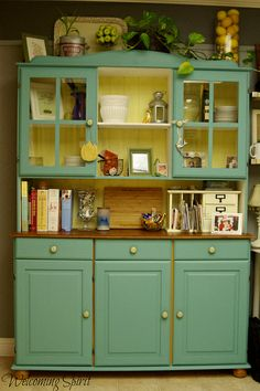 Kitchen: Painted Teal Ikea hutch: color inspiration:  teal walks, yellow interiors to cabinets and pantry>