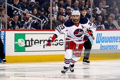 Dustin Byfuglien #33 of the Winnipeg Jets keeps an eye on the play during second period action against the Calgary Flames at the MTS Centre on January 9, 2017 in Winnipeg, Manitoba, Canada. The Jets shutout the Flames 2-0.