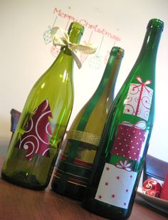 Mod Podge wine bottles with wrapping paper